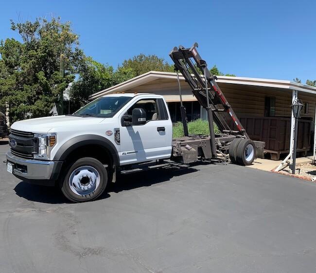 Bins 4 Less Truck Unloading a Dumpster Rental
